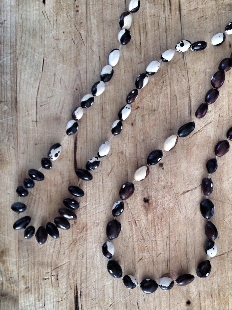 Here are necklaces made with calico beans.